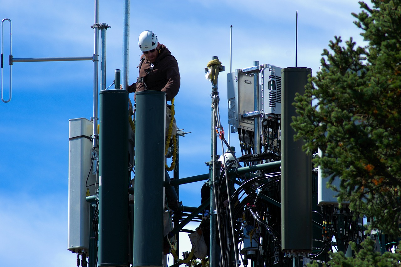 Image of Man Working on Cell Tower