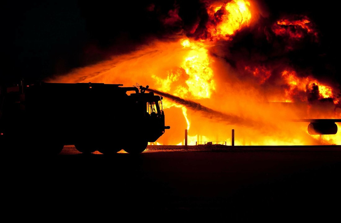 Image of Fire Truck Extinguishing Flames